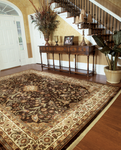 intricate large area rug in a foyer in enid