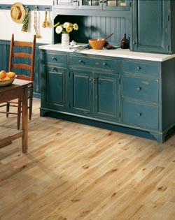 teal cabinets and hardwood kitchen flooring in enid